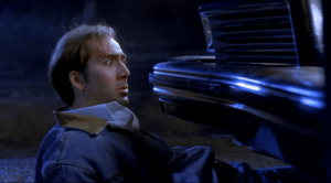 Cage stops a car with the power of his stare