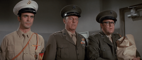 M. Emmett and the army guys get a gander at the wacky chimps