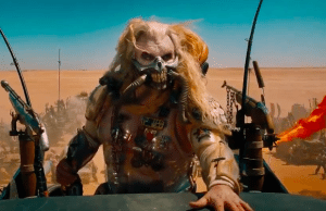 Immortan Joe cracks a smile... I think?